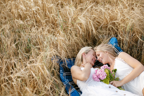 Mother with beautiful daughter in a autumn field - Stock Photo - Images