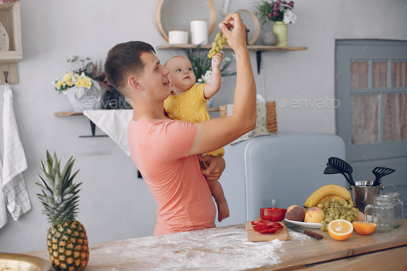 Beautiful family prepare food in a kitchen - Stock Photo - Images