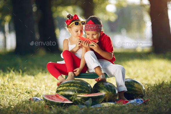 Cute little children with watermelons in a park - Stock Photo - Images