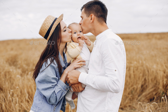 Cute family playing in a autumn field - Stock Photo - Images