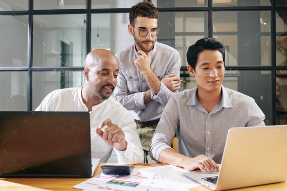 Entrepreneur checking colleagues work - Stock Photo - Images