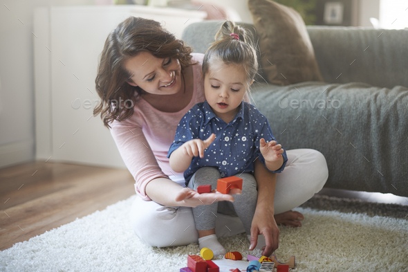 My little daughter is very capable - Stock Photo - Images