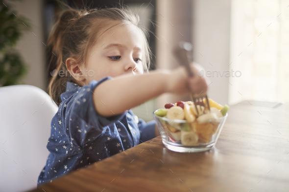 She loves eat fresh fruit - Stock Photo - Images