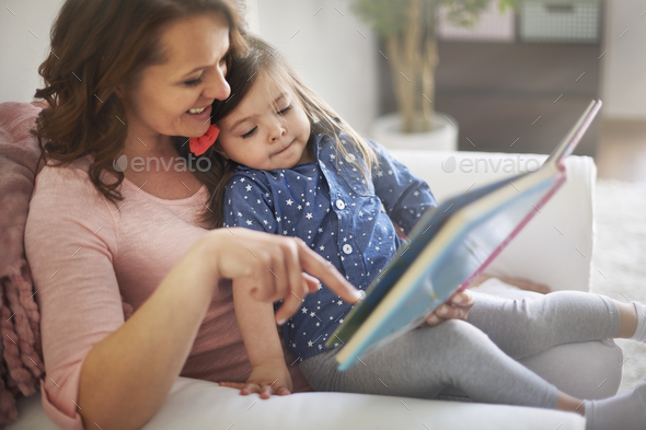 Reading books with mommy make me happier - Stock Photo - Images
