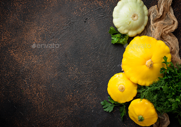 Fresh patissons on old rusty background - Stock Photo - Images