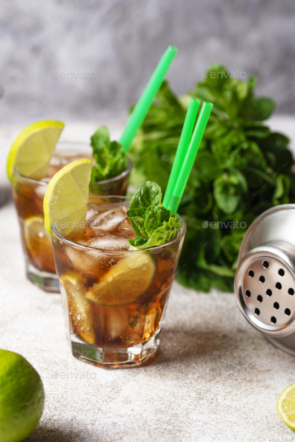 Cuba libre cocktail with mint and lime - Stock Photo - Images