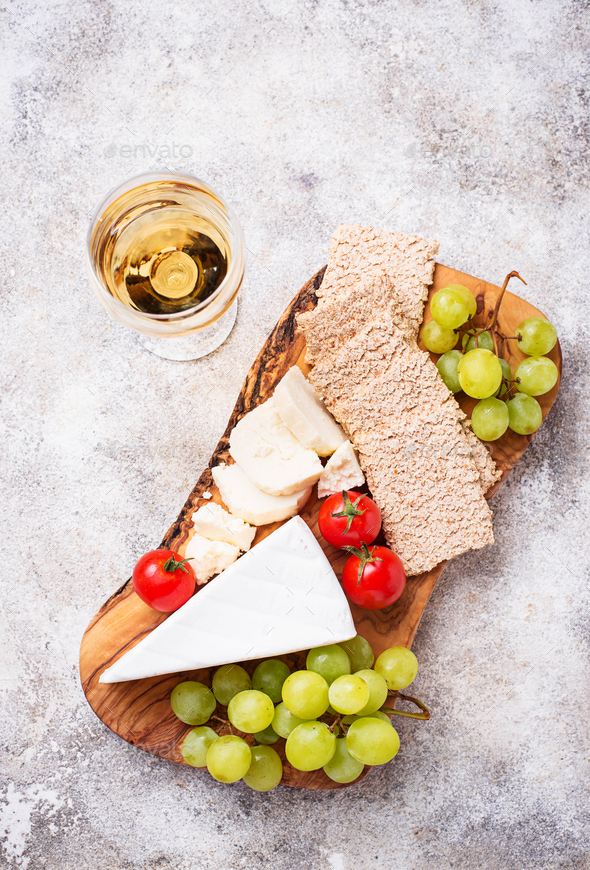 Cheese plate with brie, grape and wine - Stock Photo - Images
