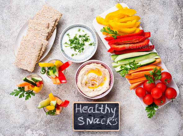 Snacks bar.  Vegetables sticks and hummus - Stock Photo - Images