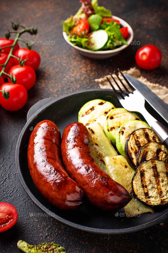 Grilled pork sausages and vegetables - Stock Photo - Images