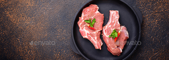 Raw meat  in cast iron pan - Stock Photo - Images