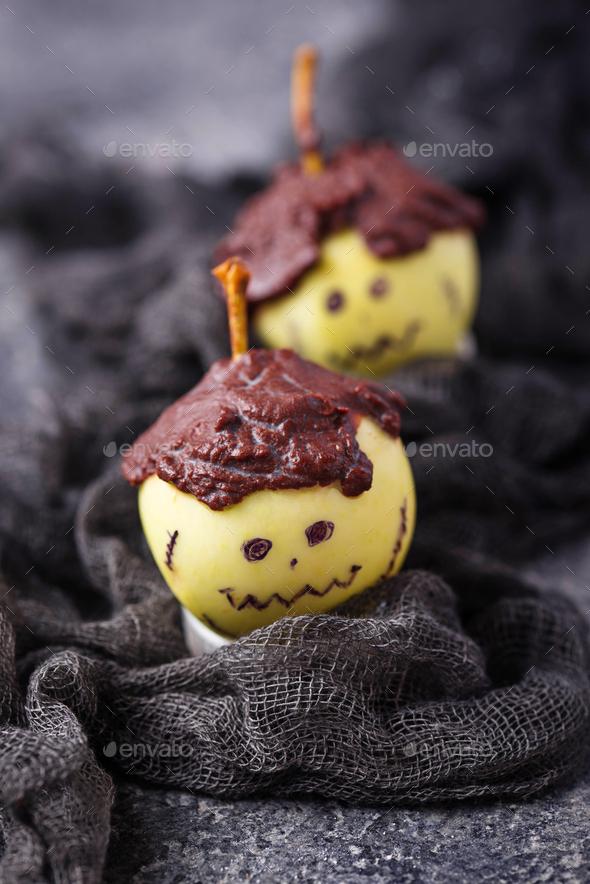 Halloween treat apple in shape of Frankenstein - Stock Photo - Images