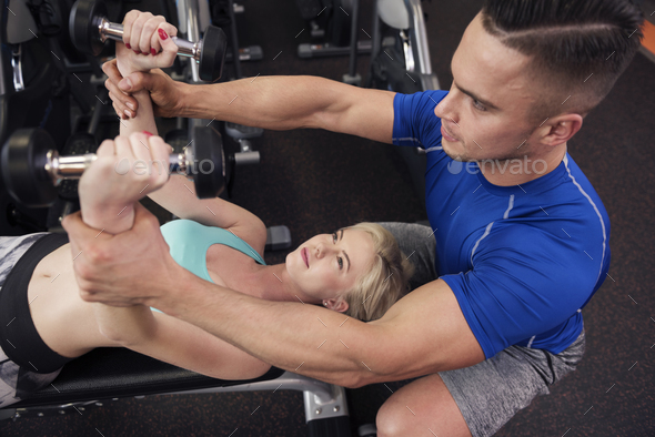 Woman exercising on weight bench - Stock Photo - Images