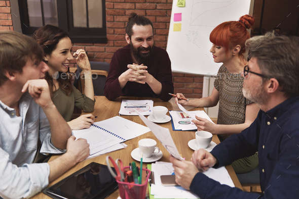 Talking about company with coworkers - Stock Photo - Images