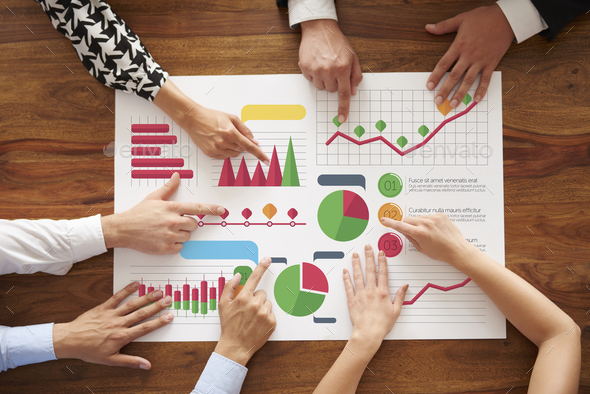 Business people analyzing many charts - Stock Photo - Images