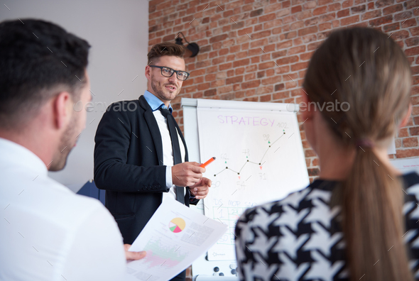 Boss analyzing some recent results - Stock Photo - Images