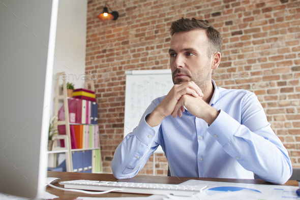 Man focused on working on computer - Stock Photo - Images