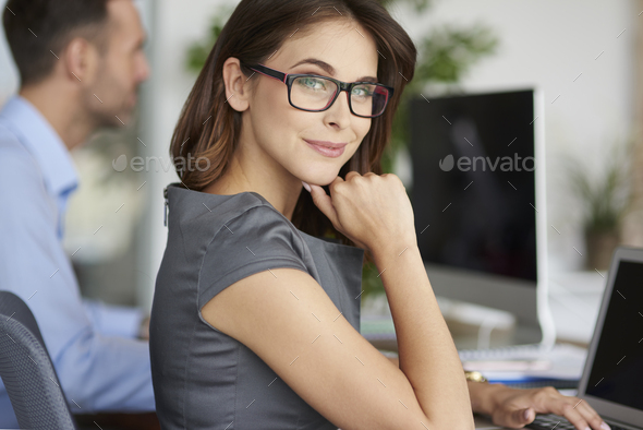 Portrait of cheerful woman at the office - Stock Photo - Images