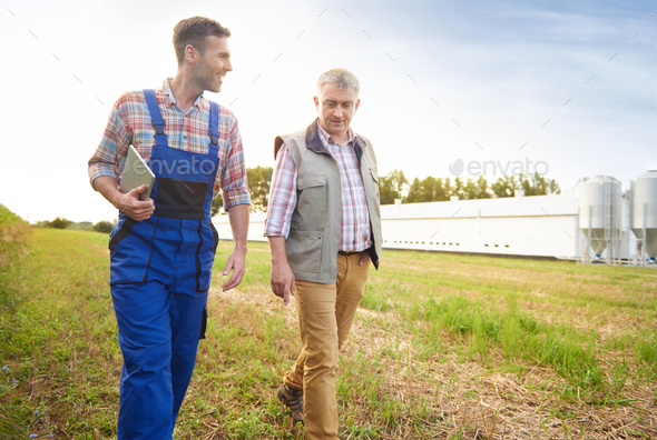 Modern farmers on the field - Stock Photo - Images