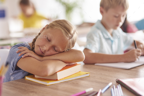 Girl sleeping during the lesson - Stock Photo - Images