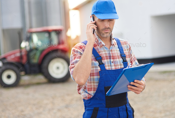 Farmer making some business calls - Stock Photo - Images