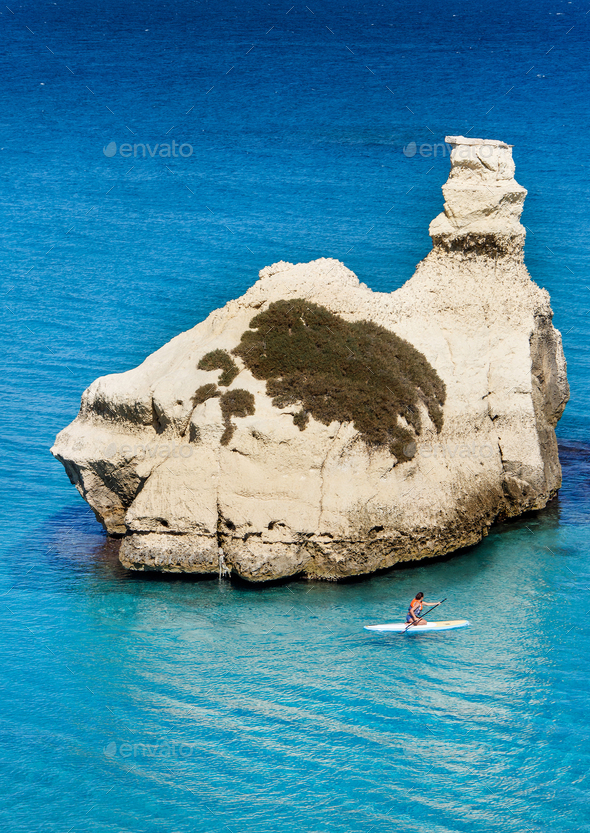 The Two Sisters stacks in front of the shore of Torre dell'Orso - Stock Photo - Images
