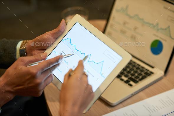 Analyzing business chart - Stock Photo - Images