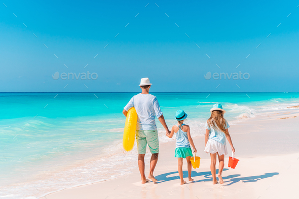 Happy beautiful family on a tropical beach vacation - Stock Photo - Images