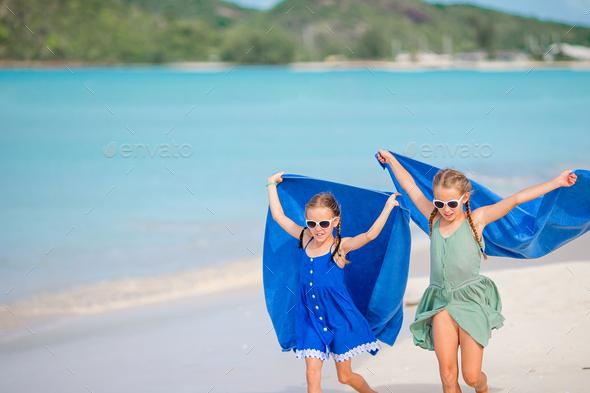 Little girls having fun enjoying vacation on tropical beach - Stock Photo - Images