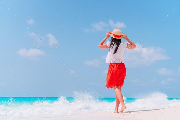 Young beautiful woman having fun on tropical seashore - Stock Photo - Images