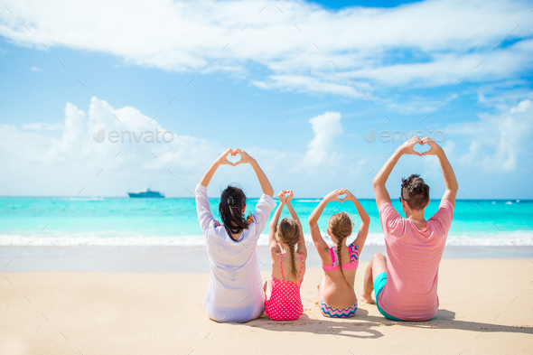 Happy family on the beach during summer vacation - Stock Photo - Images