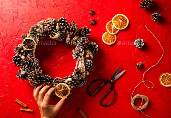 Woman Hands holding Christmas Wreath - Stock Photo - Images