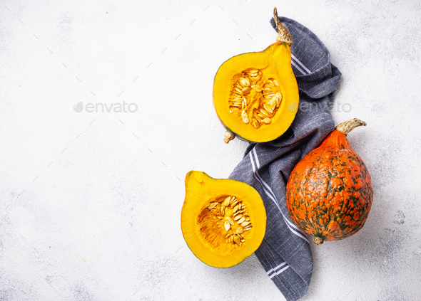 Dissected raw hokkaido pumpkin with seeds - Stock Photo - Images