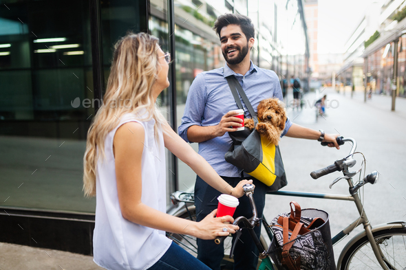 Happy young couple spending time together with dog and bicycles - Stock Photo - Images