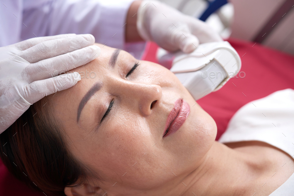 Rejuvenating facial treatment - Stock Photo - Images