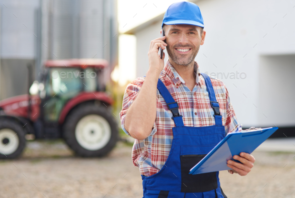 Busy farmer at his farm - Stock Photo - Images
