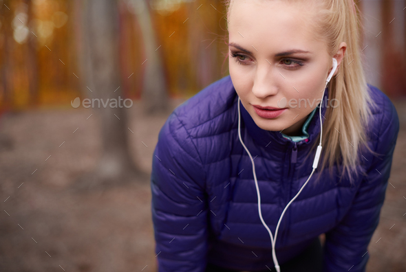 Pensive woman before her jogging marathon - Stock Photo - Images