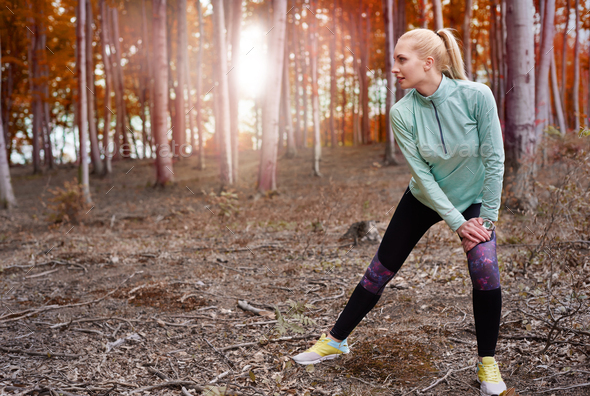 Legs stretching in the autumnal forest - Stock Photo - Images