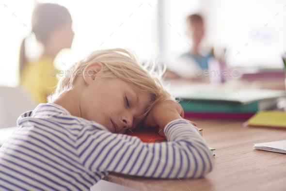 Sleepy day of elementary school pupil - Stock Photo - Images