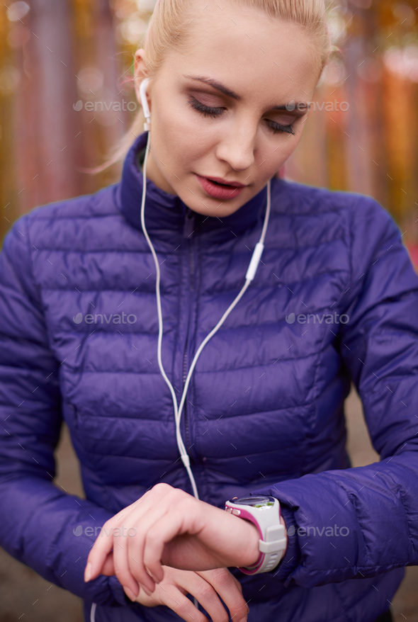 Checking the recent record in jogging - Stock Photo - Images