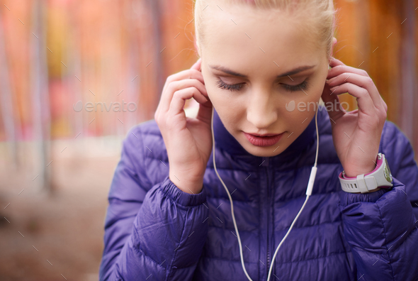 Close up of womam with earphones - Stock Photo - Images