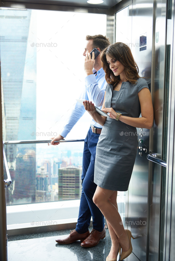 Business partners in the lift - Stock Photo - Images