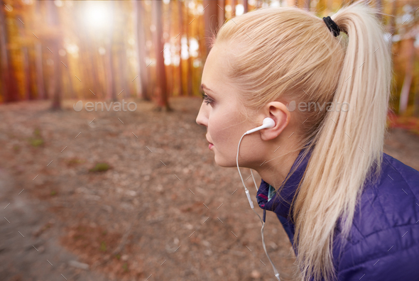 Breathing deep during jogging in the forest - Stock Photo - Images
