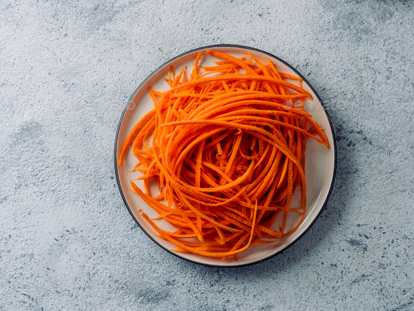 Raw carrot noodles or spaghetti, top view - Stock Photo - Images