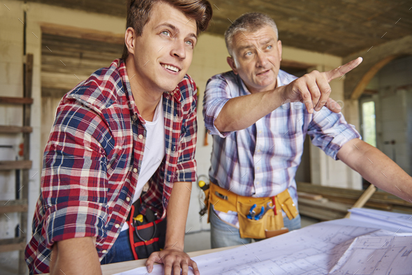 Young carpenter got some more guides - Stock Photo - Images