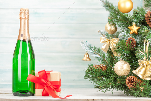 Christmas card with decorated fir tree and champagne - Stock Photo - Images