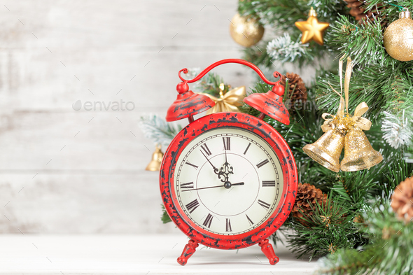 Christmas card with decorated fir tree and clock - Stock Photo - Images