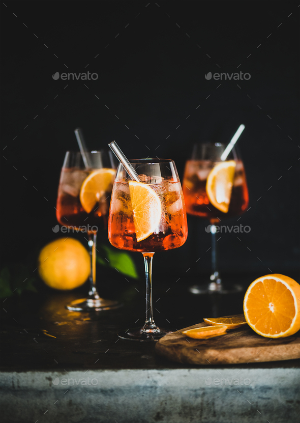 Aperol Spritz cocktail in glass with oranges, black background - Stock Photo - Images