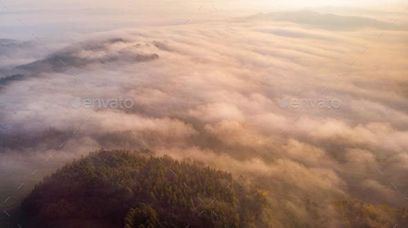 Aerial View on Fog and Clouds Above Forest at Autumn Sunrise - Stock Photo - Images
