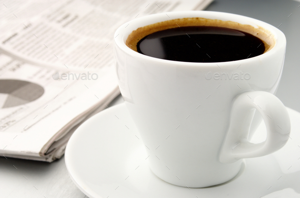 cup of coffee and a newspaper - Stock Photo - Images