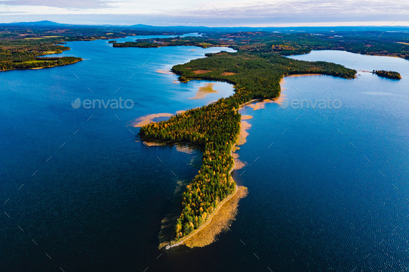Aerial view of fall landscape with blue lakes and  beautiful autumn forests in Finland - Stock Photo - Images